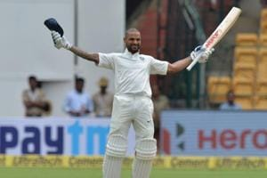 Shikhar Dhawan celebrates his century during day one of the Test match between India and Afghanistan at the M Chinnaswamy Stadium in Bangalore.