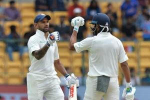 Shikhar Dhawan's century and Murali Vijay's magnificent knock put India on top in the one-off Test against debutant Afghanistan at the M Chinnaswamy Stadium in Bangalore on Thursday.