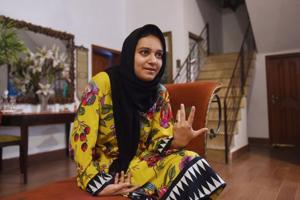 Khadeeja Siddiqui, 23, a Pakistani law student who was stabbed 23 times by a classmate after she had rejected him romantically, speaks during an interview with AFP in Lahore. Siddiqui survived the attack in broad daylight outside her sister