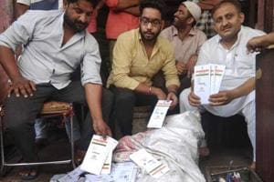 The Aadhar cards found at a scrap dealer's shop  in Jaipur.