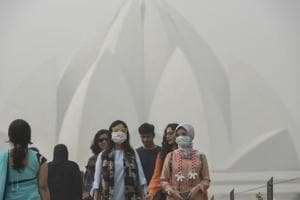 New Delhi, India - Nov. 7, 2017: Foreign tourists wearing masks as they visit Lotus Temple on a smoggy morning, in New Delhi, India, on Tuesday, November 7, 2017. The national capital's air quality dipped to 'severe' with Tuesday morning beginning on a hazy note. Reports from Haryana and Punjab also indicated similar smog-like conditions. (Photo by Burhaan Kinu/ Hindustan Times)