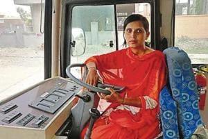 Archana on the wheel of a Karnal city bus.