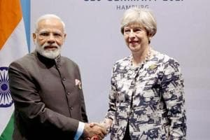 File photo of Prime Minister Narendra Modi meeting his British counterpart Theresa May on the sidelines of the G-20 Summit in Hamburg, Germany.