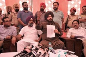 Local bodies minister Navjot Singh Sidhu along with Jalandhar cantonment MLA Pargat Singh (second from left) addressing the media in Jalandhar on Thursday.