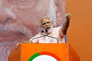 Prime Minister Narendra Modi addresses an election campaign rally ahead of the Karnataka state assembly elections in Bengaluru on May 8, 2018.