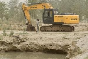 One of two digging machines still kept on the Satluj riverbed at the Goindwal village in Ludhiana on Thursday.