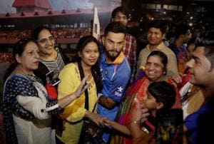 Visitors pose for photographs next to a wax figure of Indian cricket captain Virat Kohli during its unveiling at Madame Tussauds wax museum in New Delhi.