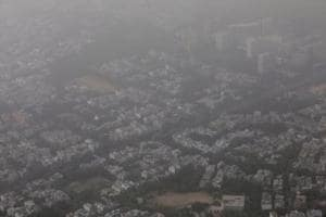 Buildings are seen blanketed by haze and dust on the outskirts of New Delhi.