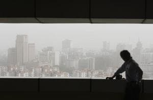 A thick blanket of dust and haze obscures New Delhi's skyline on Thursday. The sudden nosedive in Delhi's air quality has seen a spike in the number of patients with respiratory complaints.
