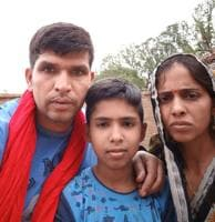 Retired Lance Naik Yagya Pratap Singh (36) with his wife and a son