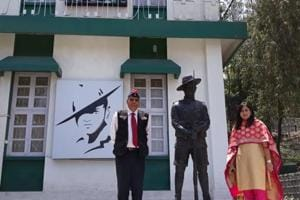 The writer with his daughter-in-law with the statue of a Gorkha Soldier.