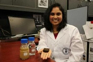 Pavani Cherukupally, a researcher at the University of Toronto, holds up a piece of sponge that is at the core of a system she has developed to remove pollutants from water.