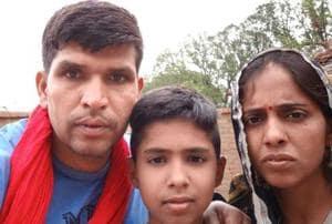 Retired Lance Naik Yagya Pratap Singh with his wife Richa and son.