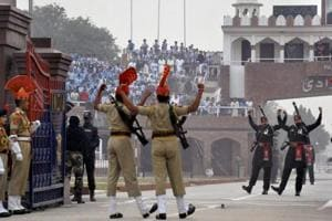 BSF and Pakistan Rangers perform the beating of the retreat ceremony at the Attari- Wagah border.