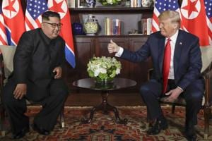 US President Donald Trump (right) gives North Korean leader Kim Jong Un a thumbs up during their meeting at a resort on Sentosa Island in Singapore on June 12.