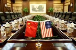Flags of US and China are placed for a meeting between Secretary of Agriculture Sonny Perdue and China