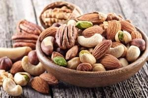 Eating several servings of nuts, such as almonds, every week may help lower the risk of developing heart rhythm irregularity.