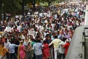 AAP protesters and supporters gathered near Mandi House in New Delhi.