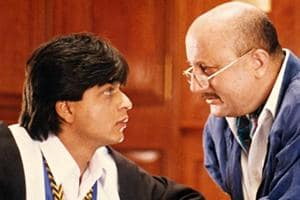 A young Shah Rukh Khan with Anupam Kher as hid dad in Dilwale Dulhania Le Jayenge.
