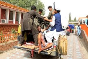 An injured being taken to hospital after the suicide bombing in Jalalabad.