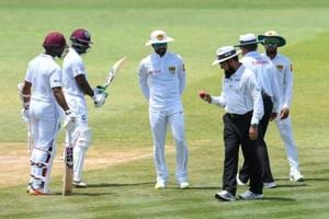 The International Cricket Council (ICC) has charged Sri Lanka captain Dinesh Chandimal (C) with 'changing the condition of the ball' during the second Test against West Indies in St Lucia.