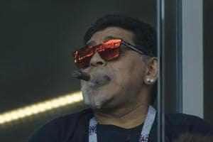 Diego Maradona smokes a cigar during the FIFA World Cup 2018 Group D match between Argentina and Iceland at the Spartak Stadium on Saturday.