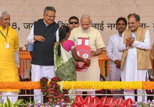 Prime Minister Narendra Modi and Chhattisgarh chief minister Raman Singh at an event in Bhilai to distribute laptops, certificates, cheques etc. to beneficiaries under various schemes.
