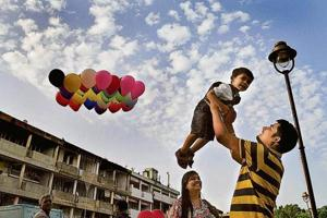A family enjoying the pleasant weather at the Sector 17 Plaza in Chandigarh.