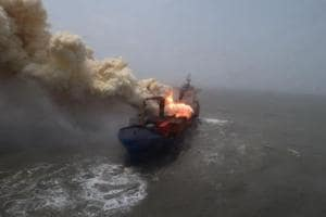 Smoke billowing out of the ship that caught fire off Bengal coast.