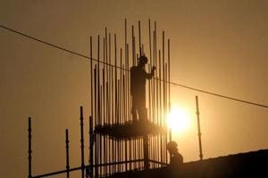 Workers on a construction site at Bhendi Bazar, in Mumbai.