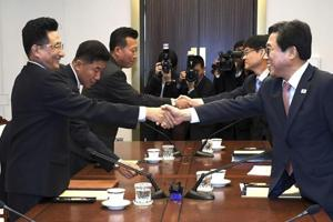 In this photo provided by the South Korea Culture And Sports Ministry, South Korean head delegate Jeon Choong-ryul (right) shakes hands with his North Korean counterpart Won Kil U during a meeting at the southern side of Panmunjom in the Demilitarized Zone, North Korea, on June 18, 2018.