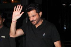 Anil Kapoor greets the paparazzi as he goes for a family dinner in Mumbai.