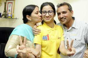 Eliza along with her Parents in a jubilant mood in Patiala after getting AIR 1st rank in AIIMS MBBS entrance test on Monday.