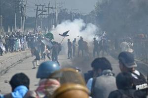 Kashmiri youths through stones during clashes between protesters and security forces in Srinagar on Saturday.