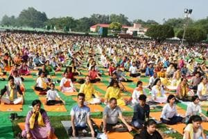 People practise yoga exercises on the FRI campus in Dehradun on Tuesday, ahead of International Yoga Day on June 21.