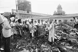 Devotees look at the damage inflicted on the Golden Temple in Amritsar after the Operation Bluestar in 1984.