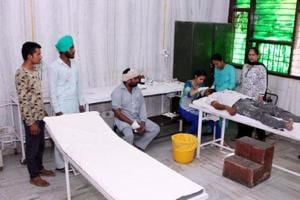 A lone medical officer handling the emergency ward as well as the OPD at Bhagta Bhai Ka 30-bed community health centre in Bathinda district.