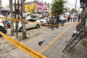 Police cordoned off the scene where two criminal gangs opened fire at each other in North Delhi