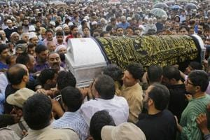 Kashmiri Muslims carry the coffin of slain editor-in-chief of the Srinagar-based newspaper Rising Kashmir Shujaat Bukhari during a funeral procession at Kreeri, some 40 kms north of Srinagar,india on June 15, 2018.