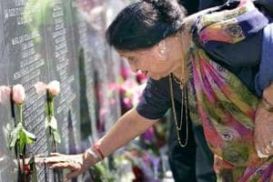 A woman at a memorial for the victims of Air India Flight 182 on the Toronto waterfront.