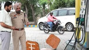 A police team inspecting the crime spot at the petrol pump on the Patiala-Zirakpur highway.