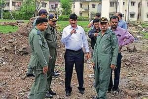 Deputy mayor Siddharth Dhende (centre) with Indian Air Force station officials at the Air Force station in Lohegaon.