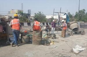 Repair work being carried out on Gill flyover in Ludhiana.