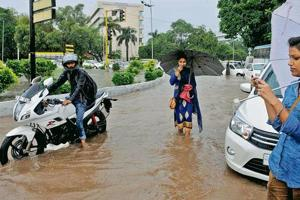 Around a trouble spot: Water-logging at the Sector 20 roundabout due to heavy rain in Chandigarh on August 21, last year.