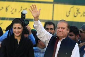 Nawaz Sharif (R), former Prime Minister and leader of Pakistan Muslim League, gestures to supporters as his daughter Maryam Nawaz looks on during party