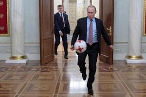 Leonid Slutsky, a former Russian national team coach, broke a taboo by naming President Vladimir Putin's biggest critic live on air during the FIFAWorld Cup 2018.