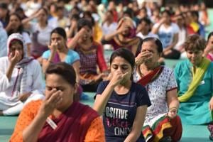 People participate in a yoga session organised on the occasion of International Yoga Day at MIT college, Kothrud.