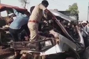 Policemen retrieving the bodies from the crushed jeep in Morena.