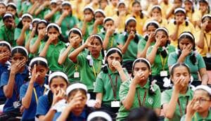 Students of Abhinav English Medium School, Ambegaon, perform a breathing exercise during the yoga session organised on the occasion of International Day of Yoga.