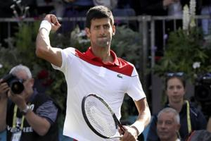 Novak Djokovic of Serbia celebrates winning his match against Grigor Dimitrov of Bulgaria during their singles tennis match at the Queen